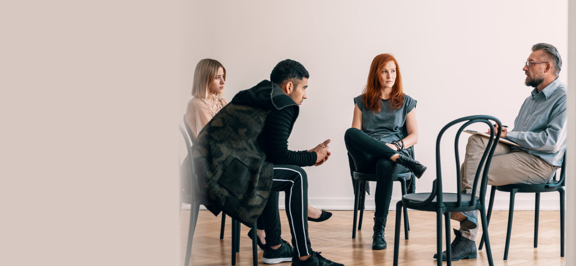 a group of people having a conversation sitting on the chair