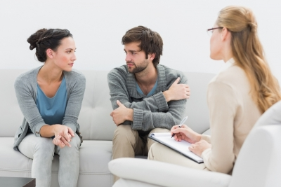 couple in meeting with a relationship therapist in her office